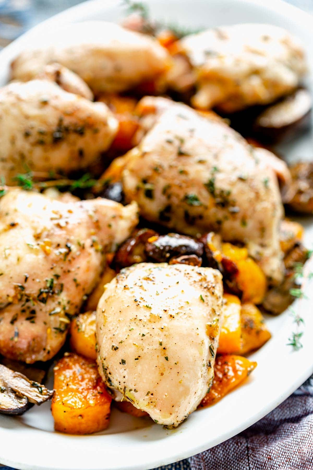 close-up of chicken and squash sheet pan dinner on a platter