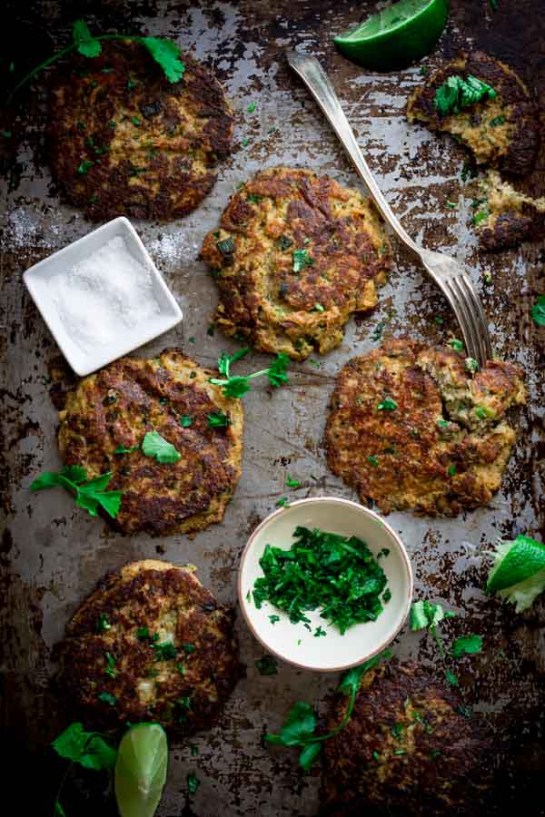Mexican Cauliflower Patties on a tray with parsley