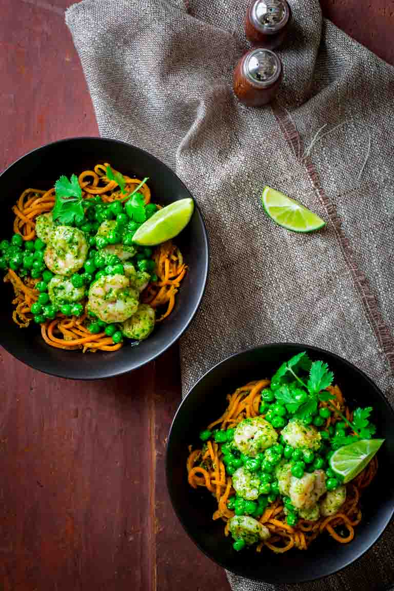 This recipe for gluten-free sweet potato noodles topped with shrimp, cilantro pesto and peas is a clean eating weeknight meal ready in under 45 minutes!
