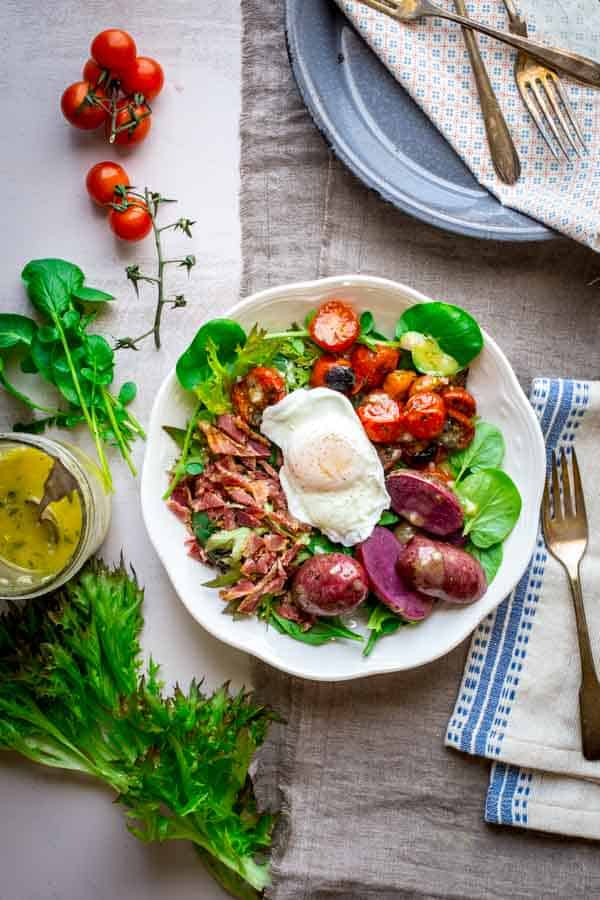 Brunch Salad with Poached Eggs, Broiled Cherry Tomatoes, Bacon and Potatoes. An amazingly satisfying and gluten-free entree salad for brunch.