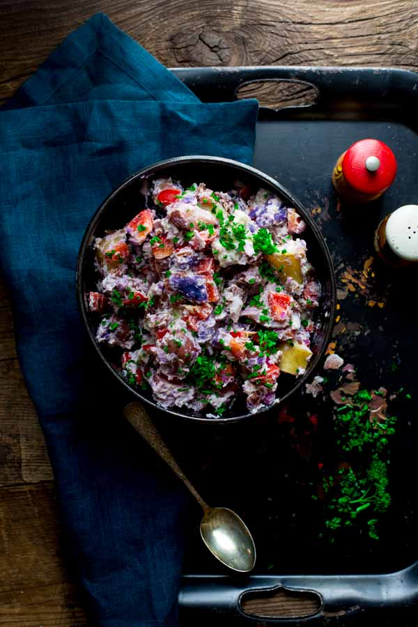 Red White and Blue Potato Salad in a black bowl