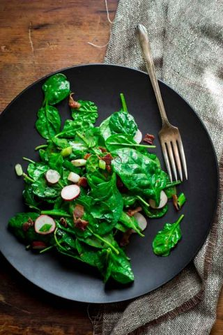 Spinach and Scallion Salad with HOT BACON dressing! Oh my! You need this salad in your life! on HealthySeasonalRecipes