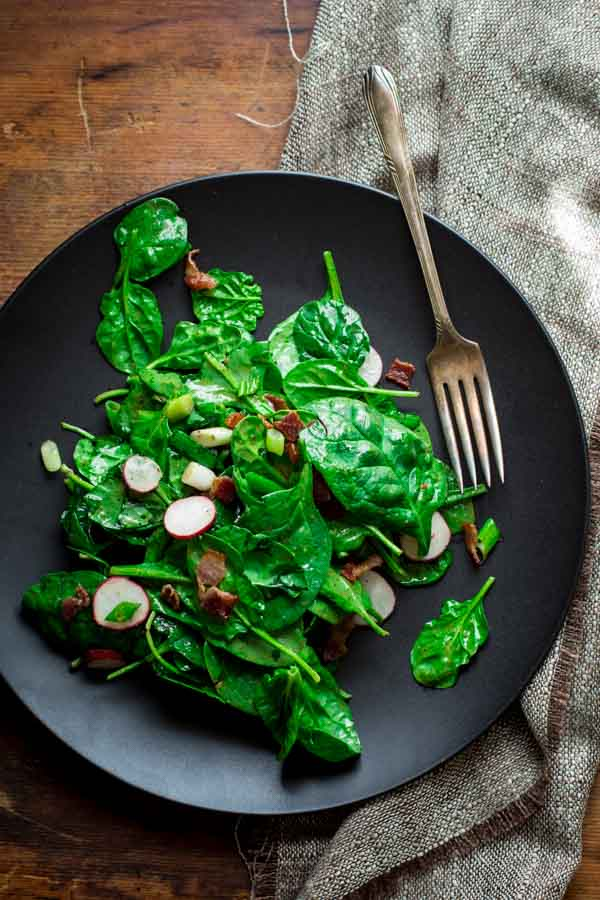 spinach and scallion salad with hot bacon dressing