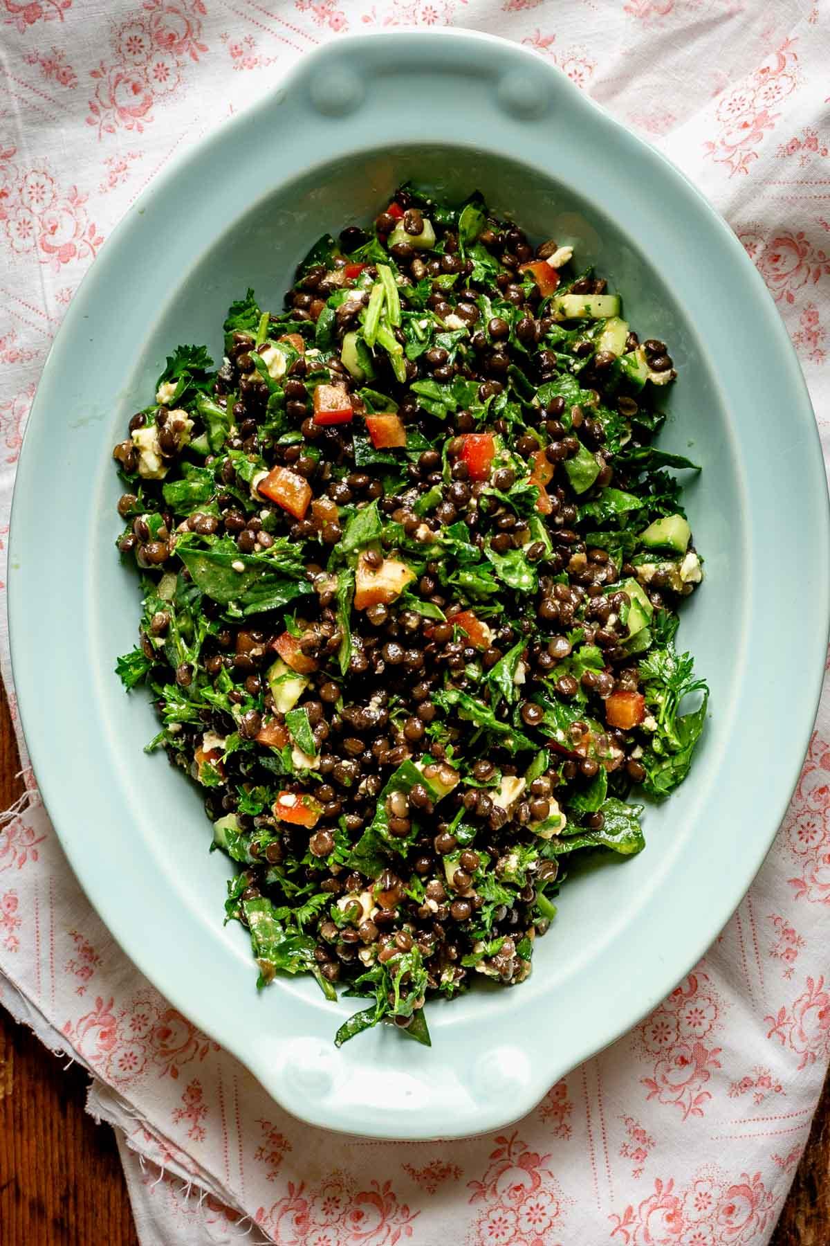 blue oval bowl with black lentil salad