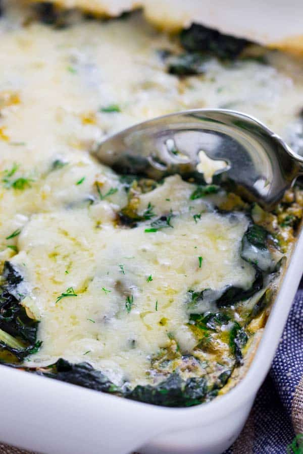 Get your greens at breakfast with this simple Chard and Egg Bake by Healthy Seasonal Recipes. Everyone will enjoy it since it's covered in cheddar cheese and it's gluten-free.
