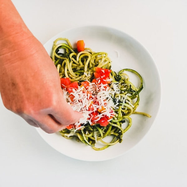Top zoodles with Parmesan