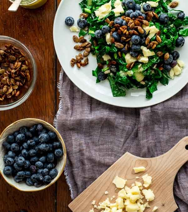 kale salad with blueberries, manchego and pumpkin seed clusters