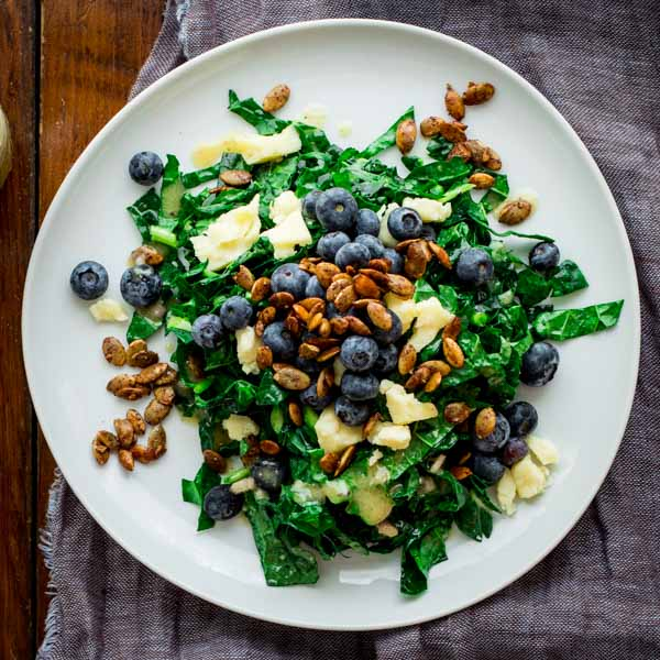 This Kale Salad with Blueberries, Manchego and Pumpkin Seed Clusters by Healthy Seasonal Recipes is loaded with nutritious ingredients that will set you right back on course after the weekend.