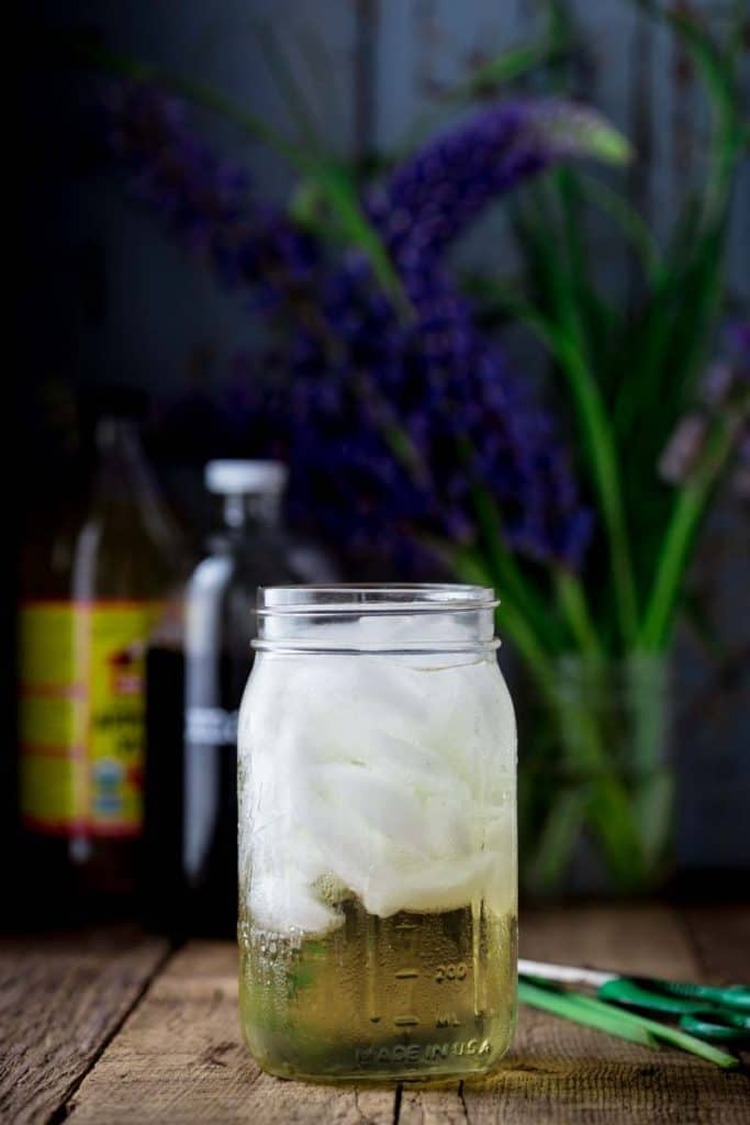 switchel in a glass jar with ice