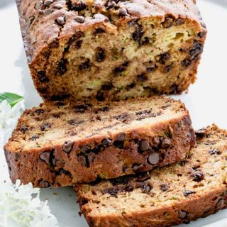a close up of slices of zucchini chocolate chip bread