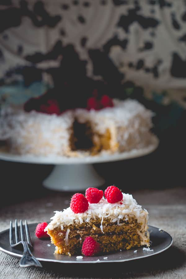 Coconut Raspberry Greek Yogurt Layer Cake by Healthy Seasonal Recipes is made with fat free Greek yogurt and whole-wheat pastry flour to make it healthier.