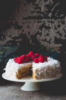 Coconut Raspberry Greek Yogurt Layer Cake by Healthy Seasonal Recipes is made with fresh raspberries, coconut sugar and fat free Greek yogurt to make it healthier.