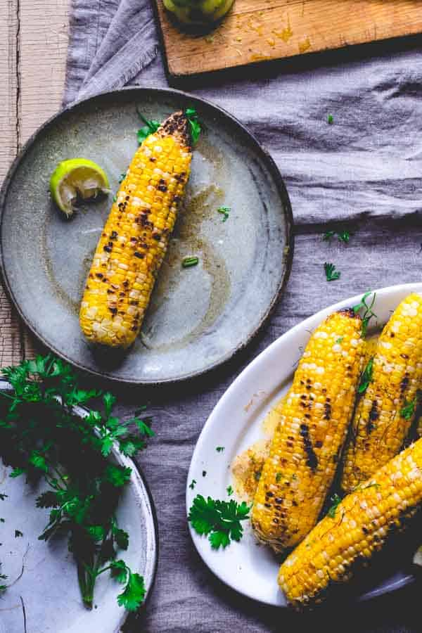 Grilled corn with chipotle lime butter is a new take on a classic side dish. Grilling the sweet corn adds another layer of flavor.