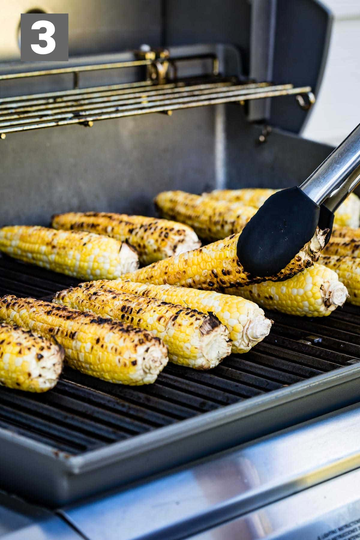 grill the corn until it is charred lightly on all sides