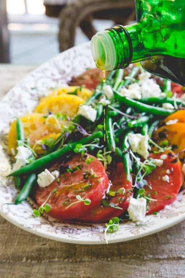 This luscious tomato and green bean salad from Healthy Seasonal Recipes is just a riot of color and juicy summer time produce side-dish mayhem!