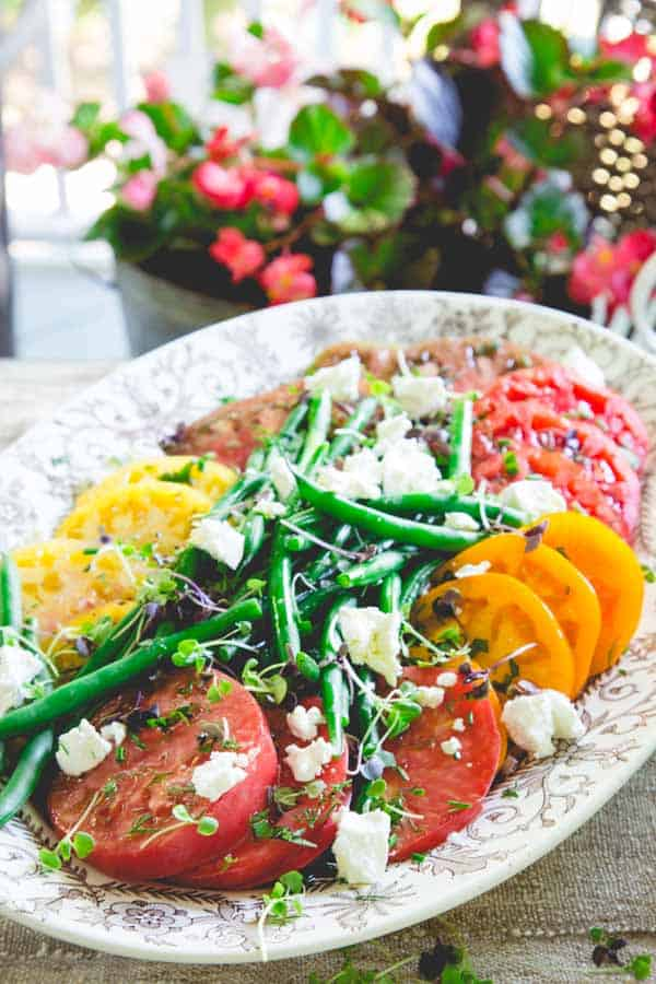 This luscious salad by Healthy Seasonal Recipes is so simple to make and is a celebration of great ingredients: heirloom tomatoes, garden-fresh green beans and crumbled fresh goat cheese!
