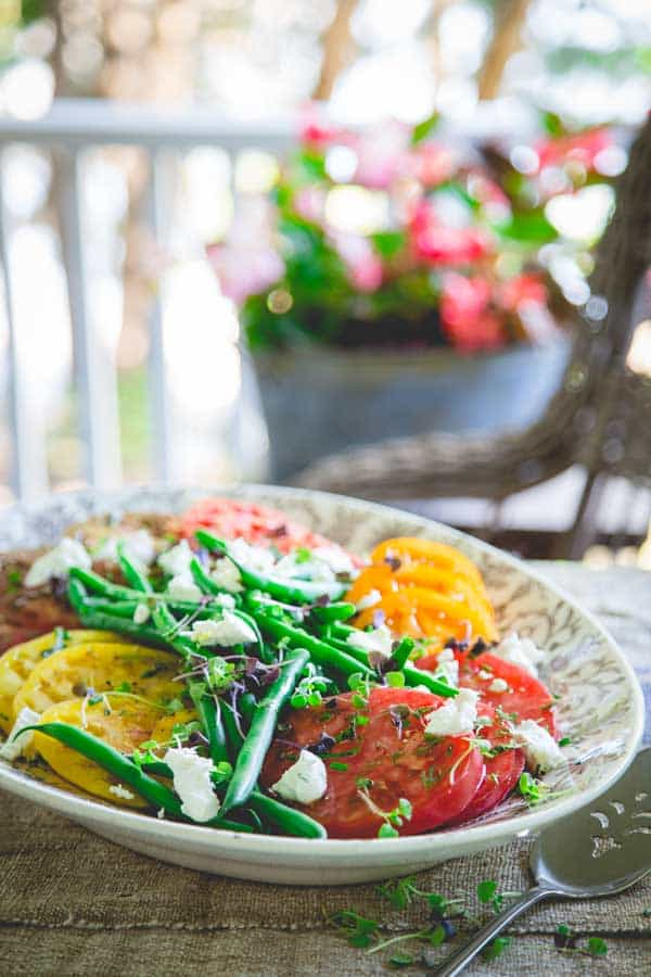 This luscious tomato and green bean salad is just a riot of color and juicy summer time produce side-dish mayhem!
