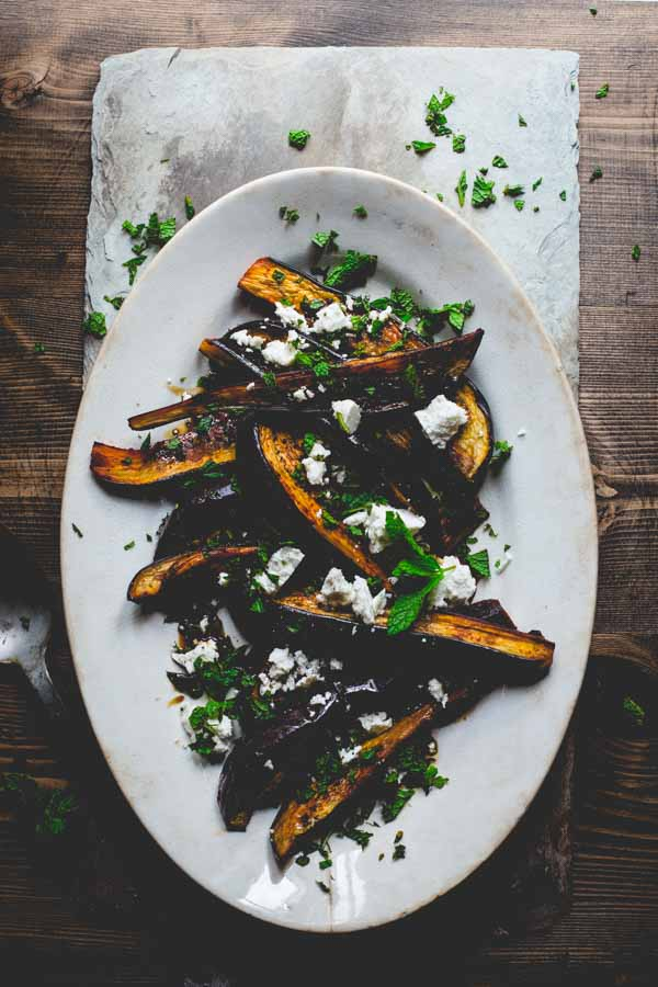 This roasted eggplant with pomegranate molasses, feta and mint by Healthy Seasonal Recipes is a simple and delicious summer side dish ready in 30 minutes.