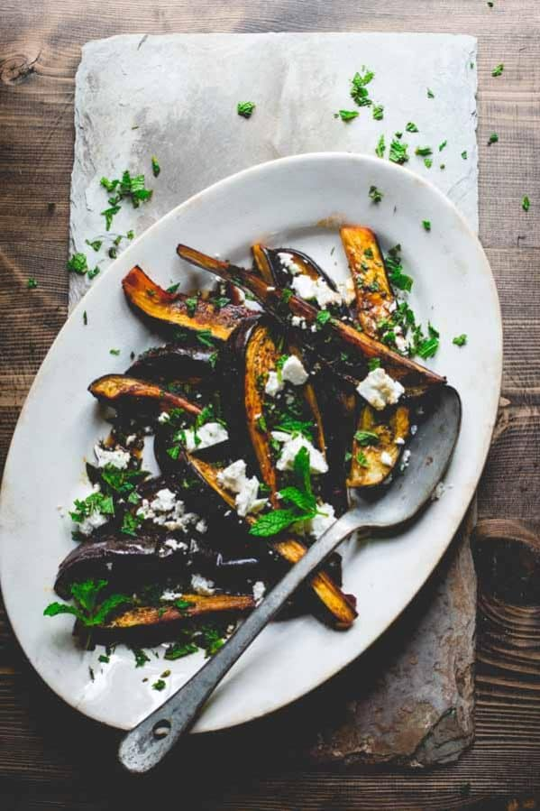 This roasted eggplant with pomegranate molasses, feta and mint by Healthy Seasonal Recipes is the perfect summer side dish because it's loaded with flavor and is ready in just 30 minutes.
