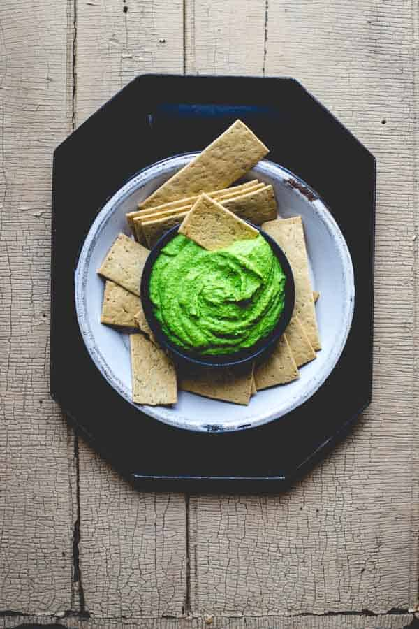 This protein packed, vegan, super green edamame hummus by Healthy Seasonal Recipes is bursting with nutrients and is great in a tortilla roll-up for the kids' lunch boxes.