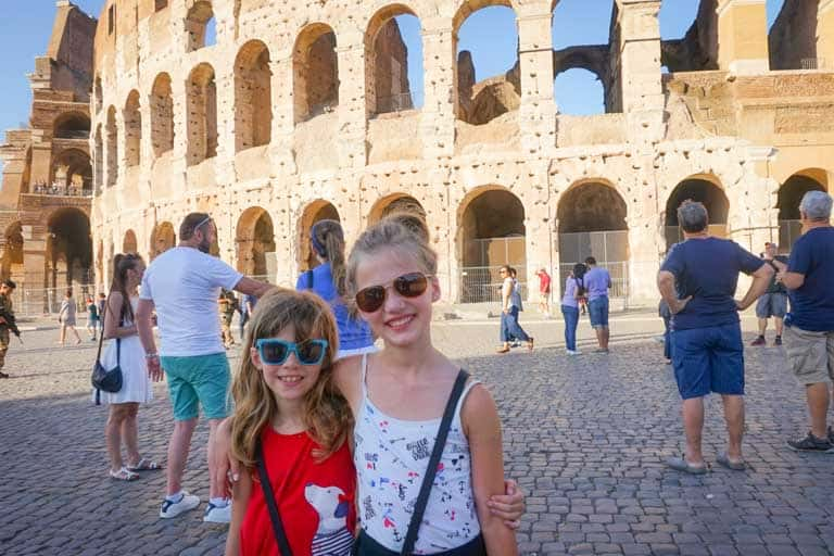 Girls at the colosseum during their family trip to Italy Healthy Seasonal Recipes.