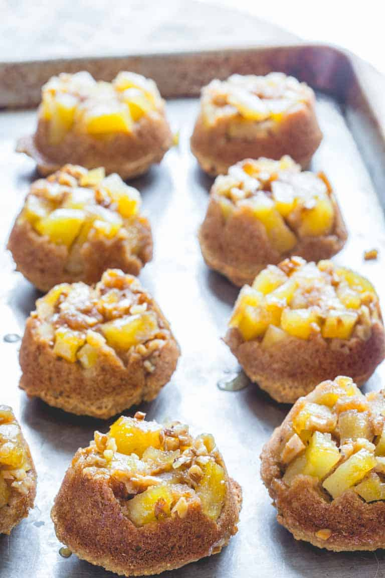 These kid friendly upside-down apple muffins by Healthy Seasonal Recipes are a great after school snack and they're low in sugar.