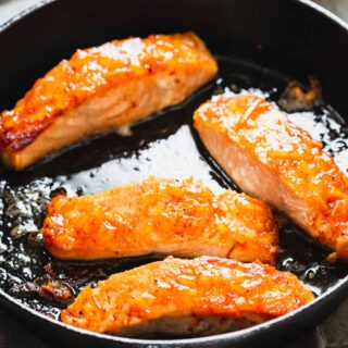 glazed salmon in a skillet, close up