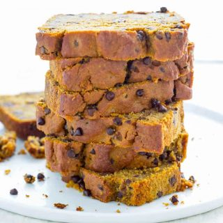 a stack of Healthy Chocolate Chip Pumpkin Bread on a white plate