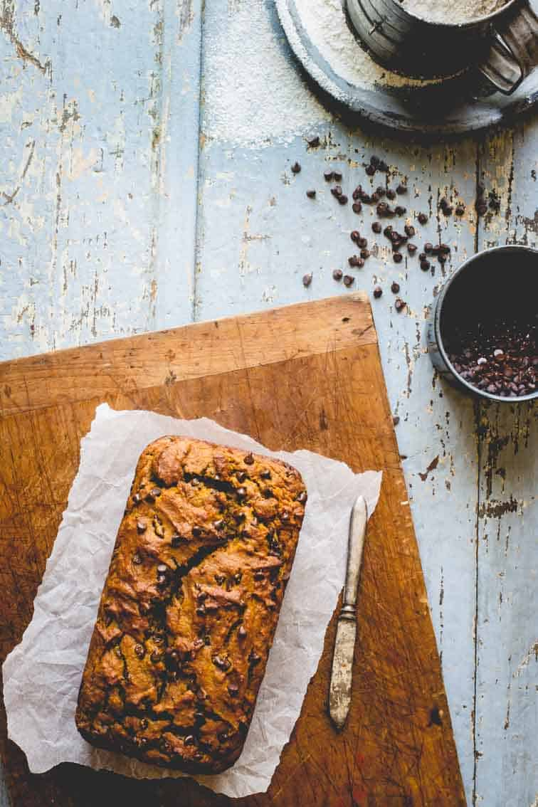 Healthy Chocolate Chip Pumpkin Bread on a cutting board