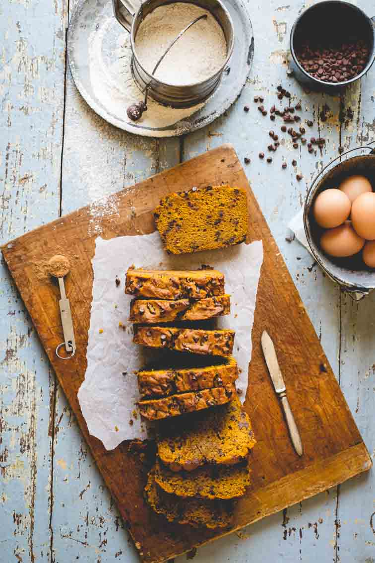 Healthy Pumpkin Bread sliced on a cutting board