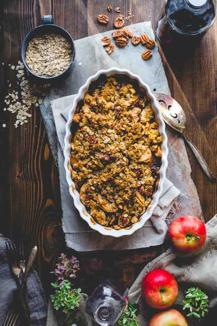 healthy apple crisp in baking dish on top of towels