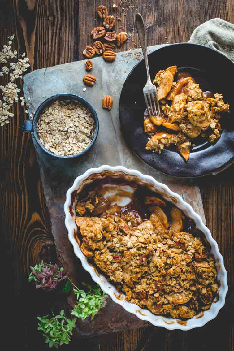 healthy apple crisp in baking dish and on plate