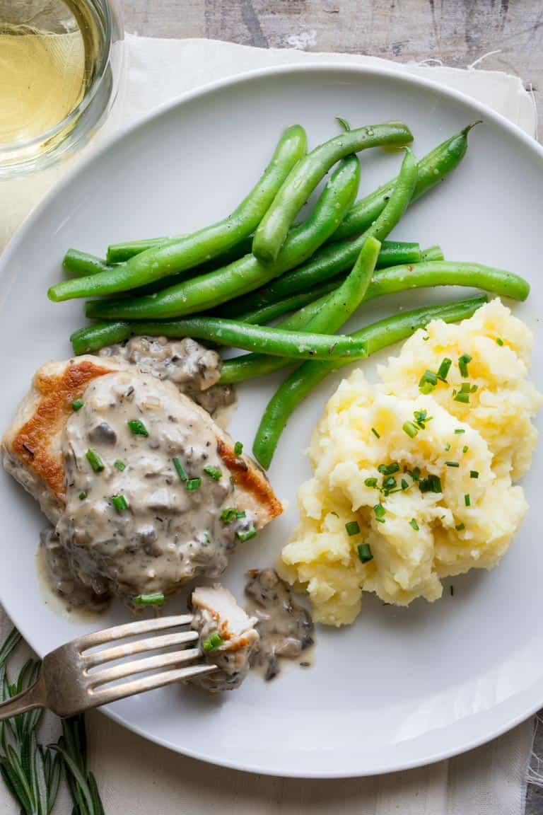Pork Chops with Creamy Mushroom Gravy from scratch. Just like the version made from canned soup, but so much healthier and made with fresh mushrooms! Healthy Seasonal Recipes by Katie Webster #mushroom #gravy #Pork #comfortfood