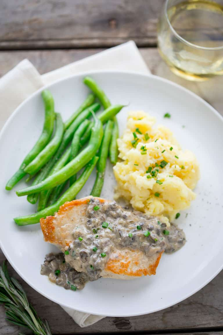 Pork Chops with Creamy Mushroom Gravy from scratch in one skillet in just 30 minutes! Just like the version made from canned soup, but so much healthier and made with fresh mushrooms! Healthy Seasonal Recipes by Katie Webster #mushroom #gravy #Pork #comfortfood