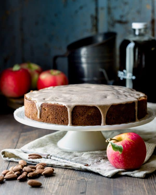 an apple cake on a cake stand