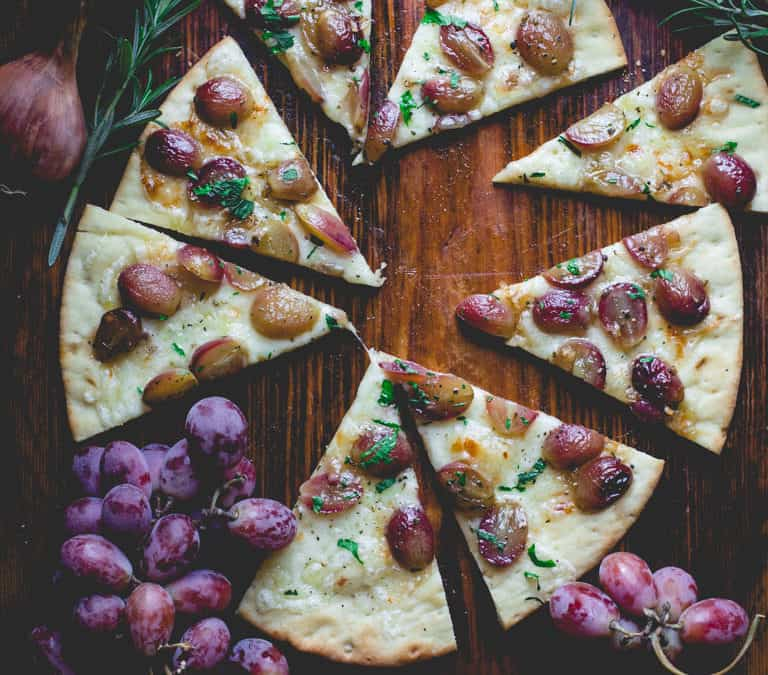 pizza with roasted grapes and rosemary