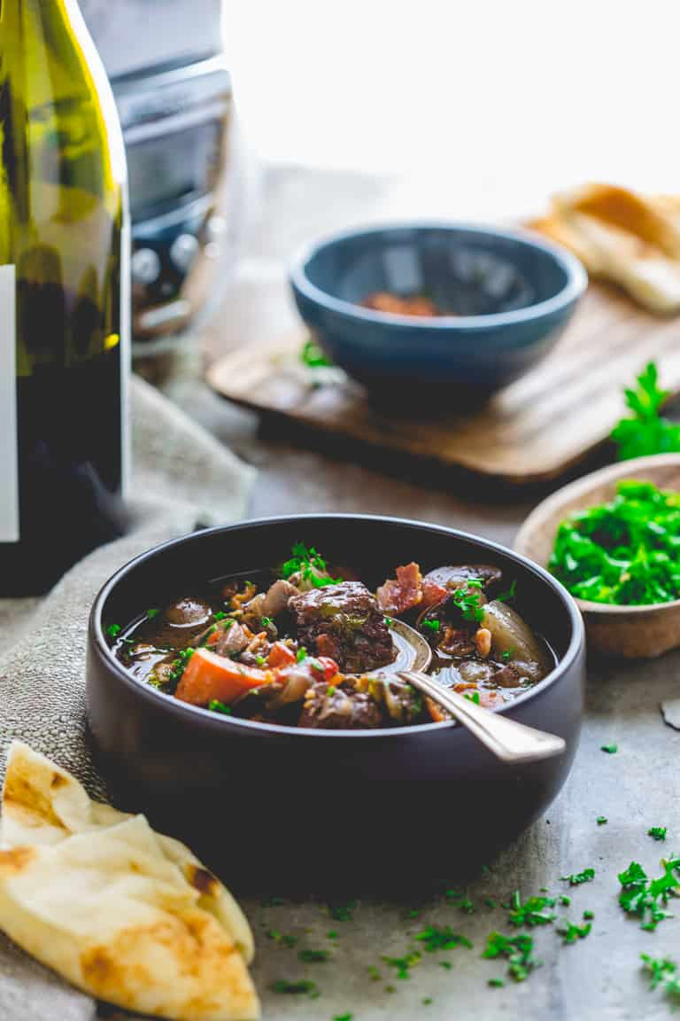 bowl of slow cooker beef burgundy with a spoon