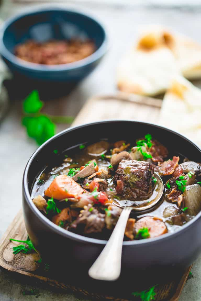 slow cooker beef burgundy in bowl with a spoon