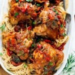 chicken on a platter of pasta
