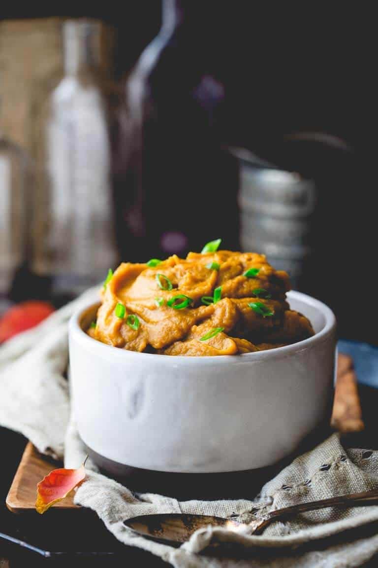 healthy mashed sweet potatoes in white bowl