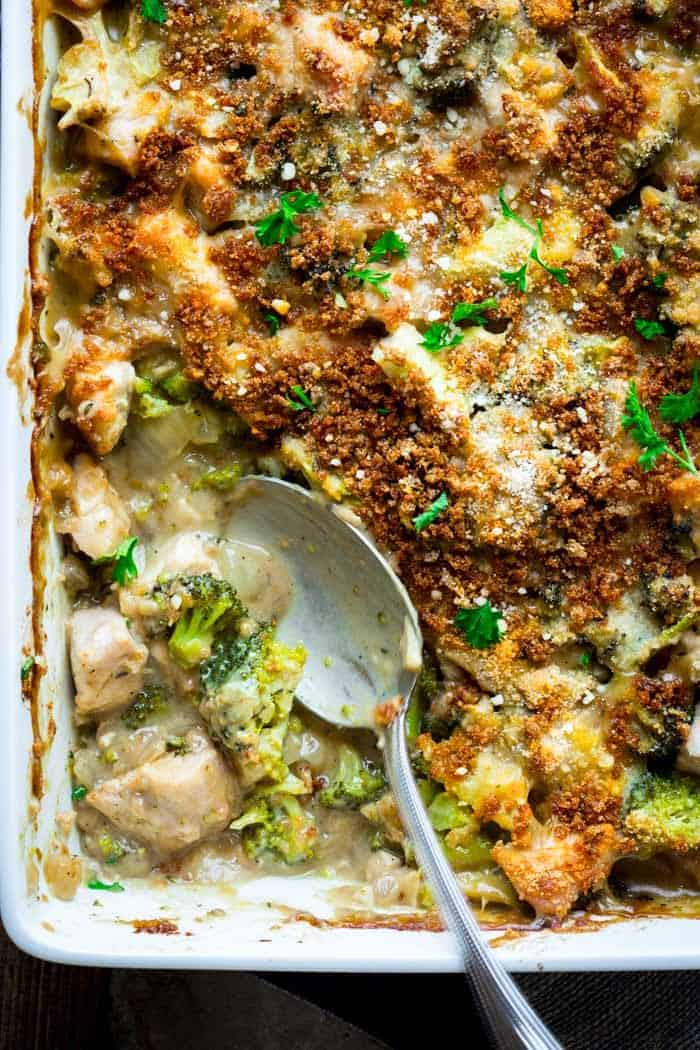 A close up look into a casserole of chicken divan with broccoli