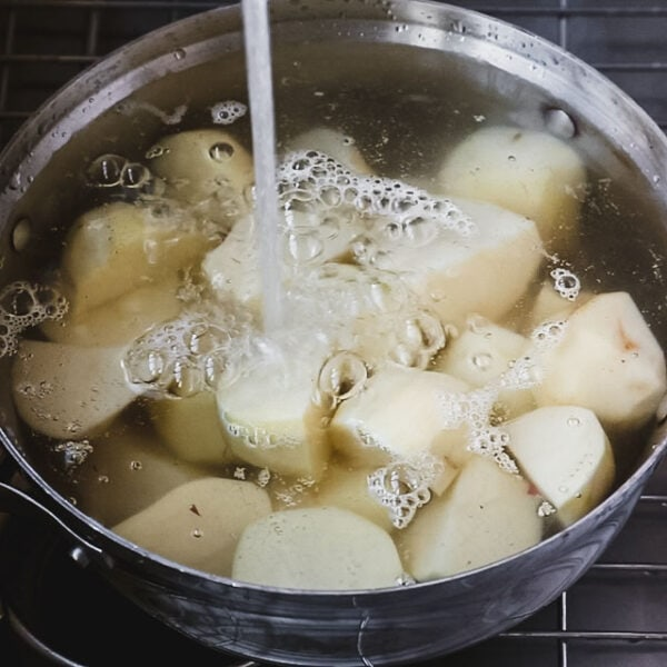 pour cold water over the potatoes