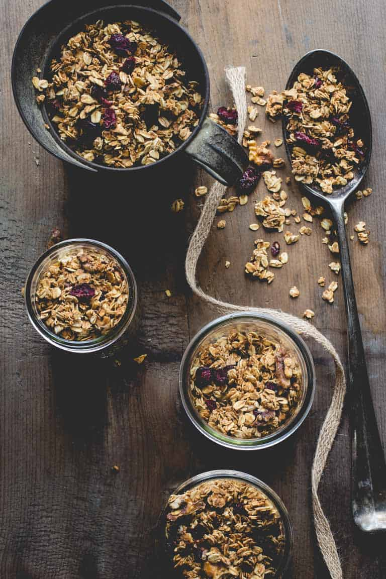 Maple Granola with Cranberries and Walnuts in jars