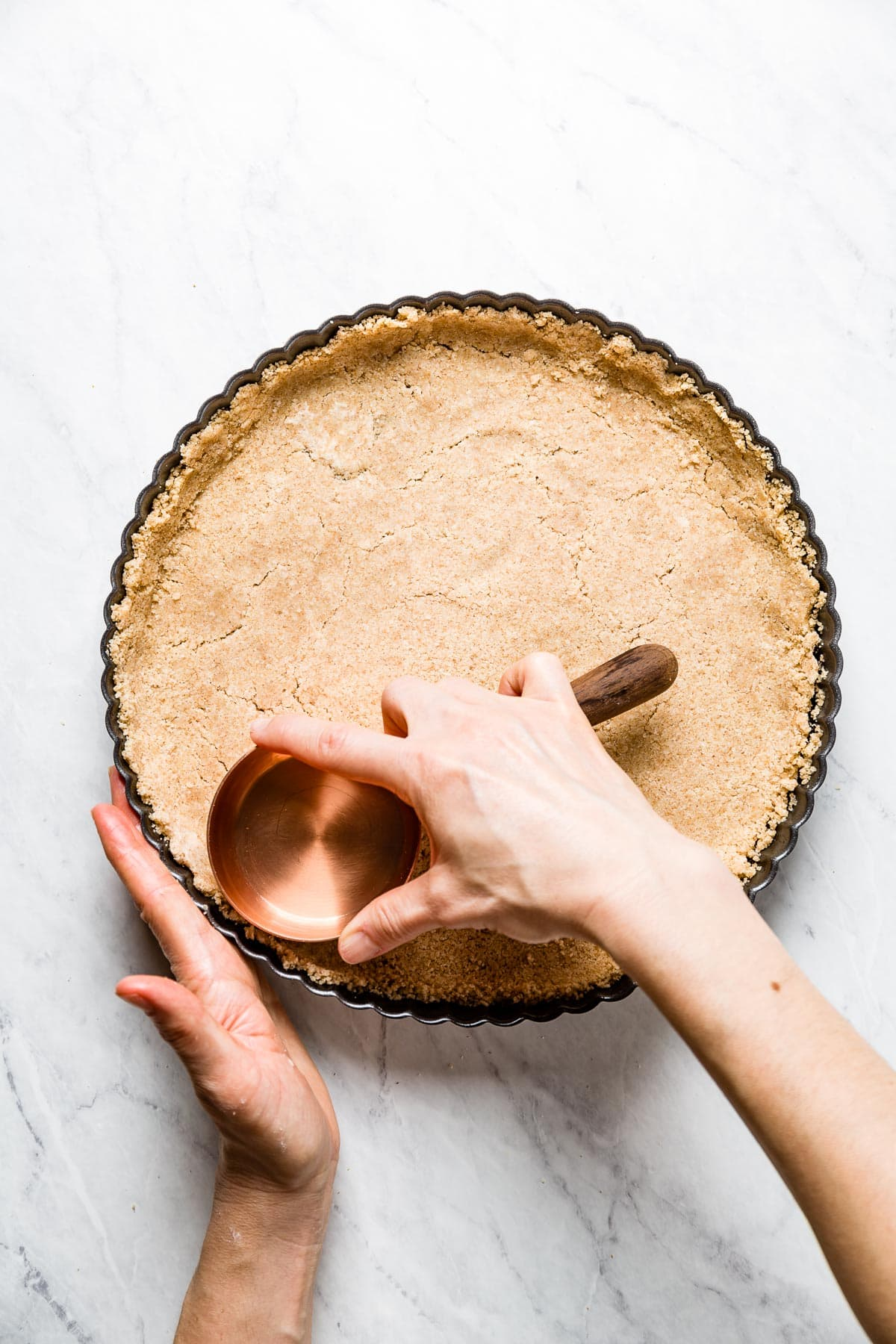 pressing the tart shell dough into place