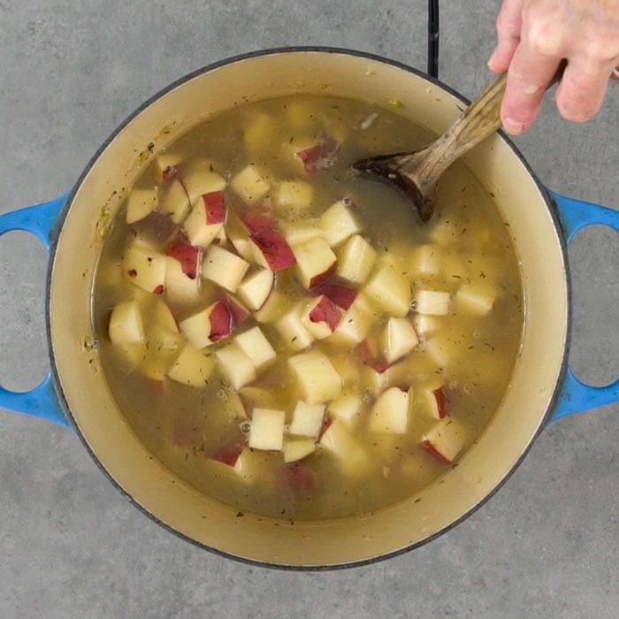Add the liquid and potatoes
