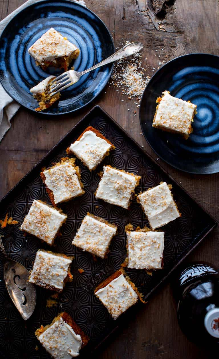 slices of healthy carrot cake on tray and plates