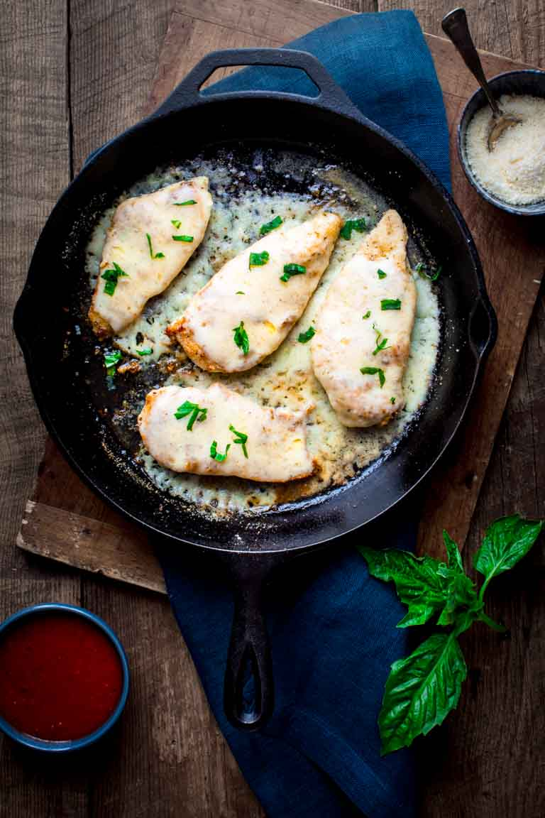 making healthy chicken parmesan in a skillet