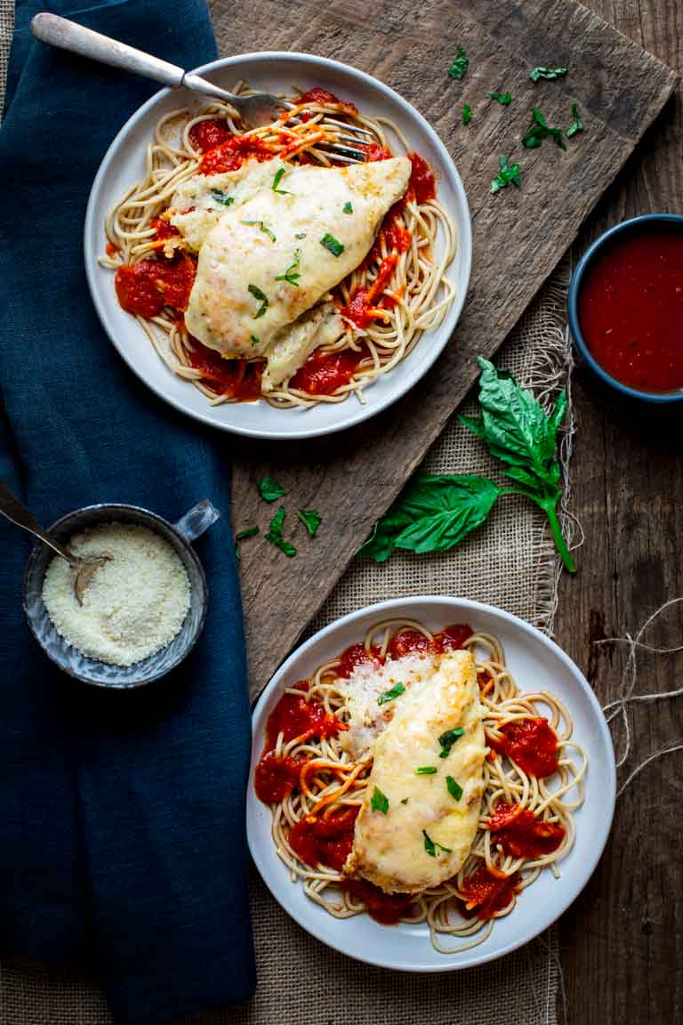 healthy chicken parmesan on top of pasta