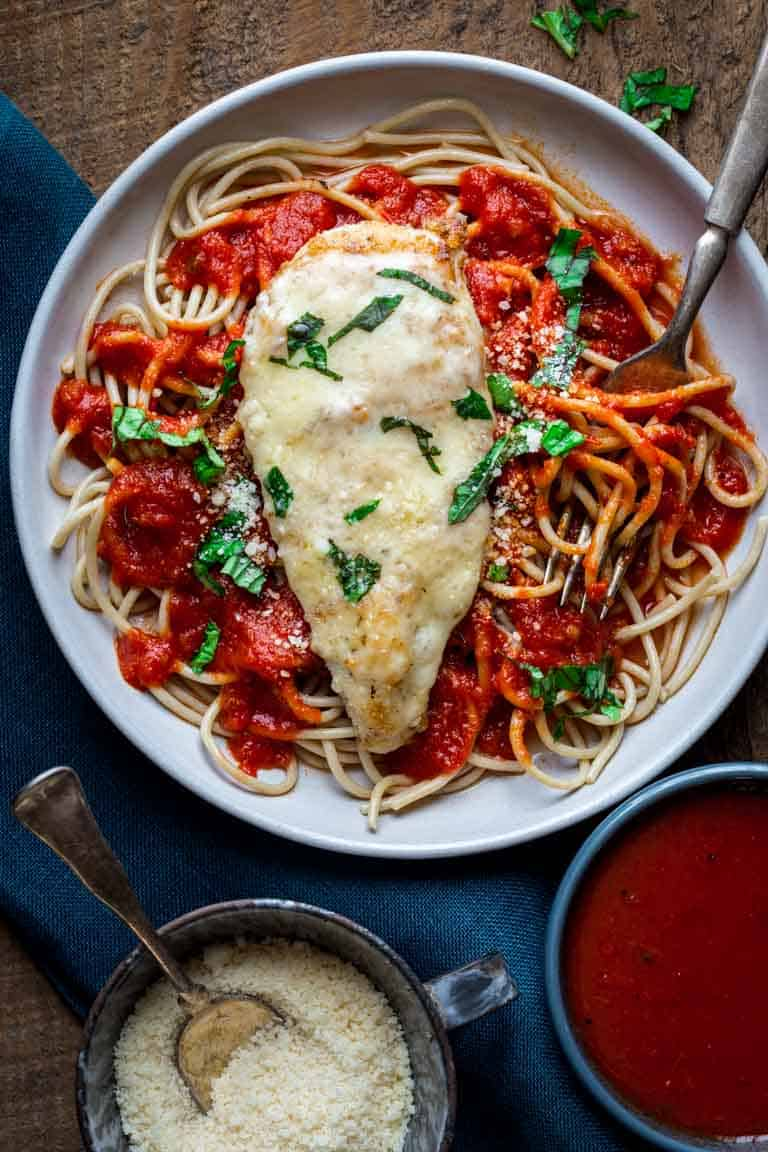 This Healthy 30 Minute Chicken Parmesan is ready in 30 minutes making it a perfect weeknight dinner. It's a healthier version of the traditional recipe. Healthy Seasonal Recipes | Katie Webster