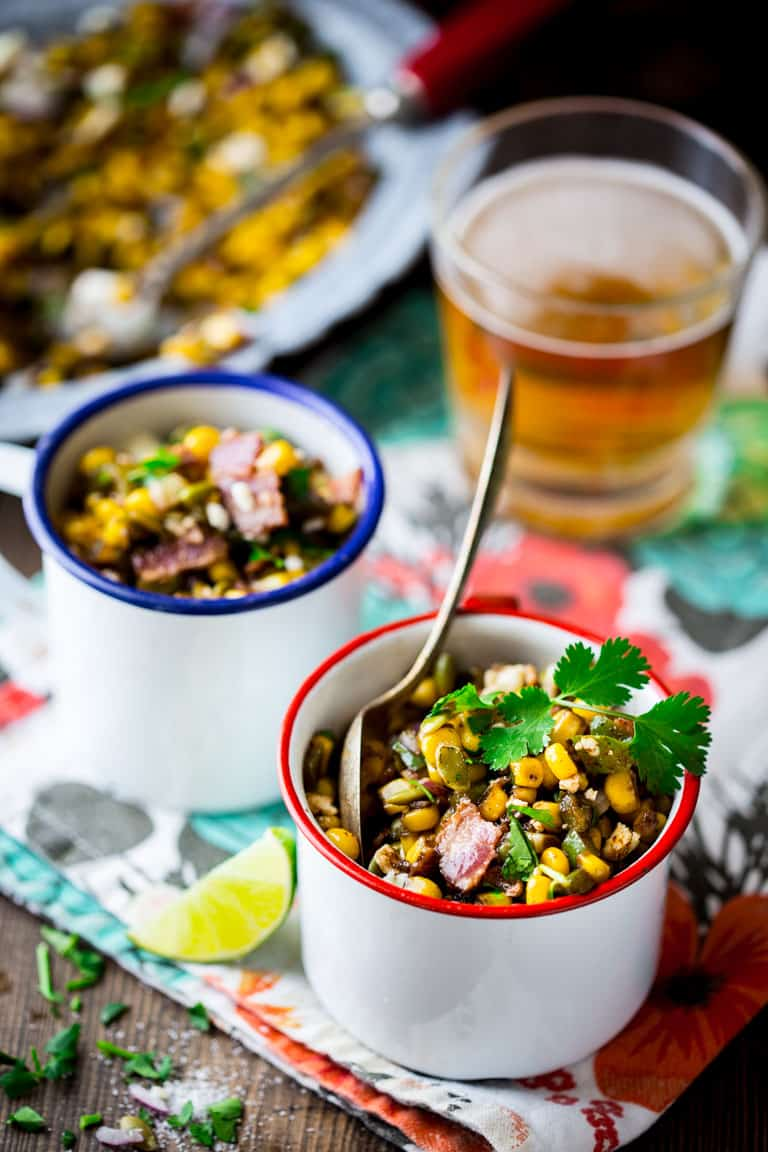This Loaded Mexican Street Corn Sauté is an easy skillet side dish variation of Mexican street corn made with frozen corn and topped with flavorful additions like pepitas, Cotija cheese, bacon, pickled jalapenos and cilantro and is ready in less than 10 minutes. Healthy Seasonal Recipes   Katie Webster